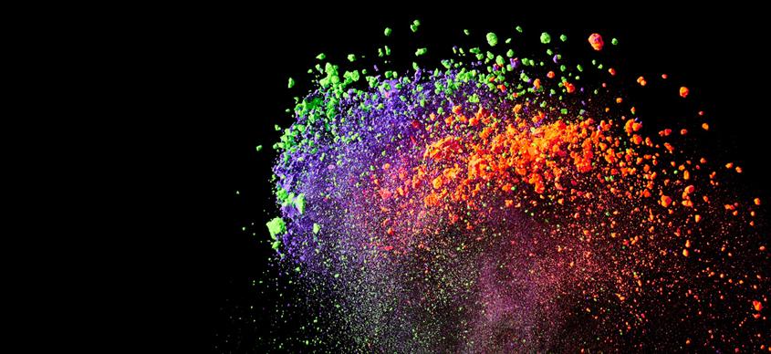 Splash of colourful powder on black background